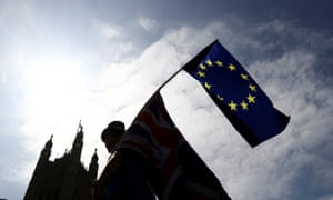 An anti-Brexit protester waves an EU flag opposite the Houses of Parliament on 8 June.
