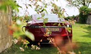 the rear of the tesla model s plugged in and charging