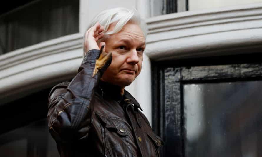 Julian Assange is seen on the balcony of the Ecuadorian embassy in London last year