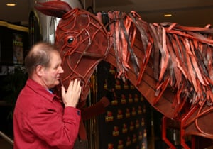 The mane idea … Michael Morpurgo with the puppet Joey from the stage production of War Horse.