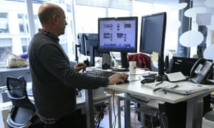 A worker at a standing desk