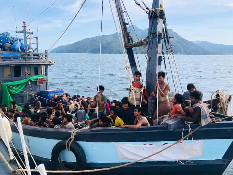 A boat carrying suspected ethnic Rohingya migrants is seen detained in Malaysian territorial waters, in Langkawi, Malaysia, 5 April