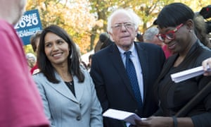 Tulsi Gabbard (left) with Bernie Sanders at a rally to stop the Trans-Pacific Partnership (TPP) on 17 November.