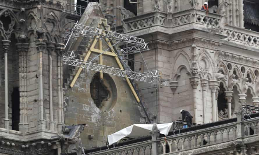Workers install tarpaulins at Notre Dame Cathedral