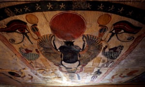 The painted ceilings inside the tomb.
