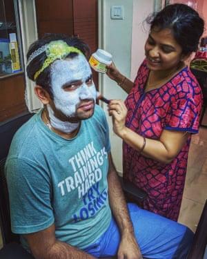 Sneha applies a face mask for her partner, Sourabh.