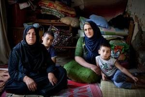 Majada Abdul Rachman, her daughter, Amal Abbas Ahmed, and grandsons, in Jalawla, Iraq