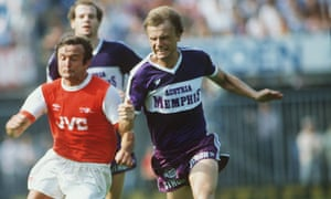 Austria Vienna's Erich Obermayer races John Hollins during the 1982 Rotterdam tournament match against Arsenal, bearing the cigarette brand 'Memphis' on his shirt.