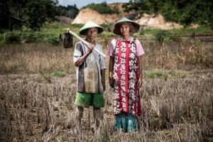 Komari, a 50 year-old farmer, and his wife Nurbaiti, at their damaged farm near a coal mine site in Makroman