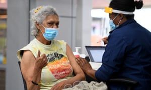 Wiradjuri elder and indigenous rights activist Aunty Jenny Munro receives a Covid-19 vaccine at a pop-up vaccination clinic at the National Centre of Indigenous Excellence in Redfern, Sydney