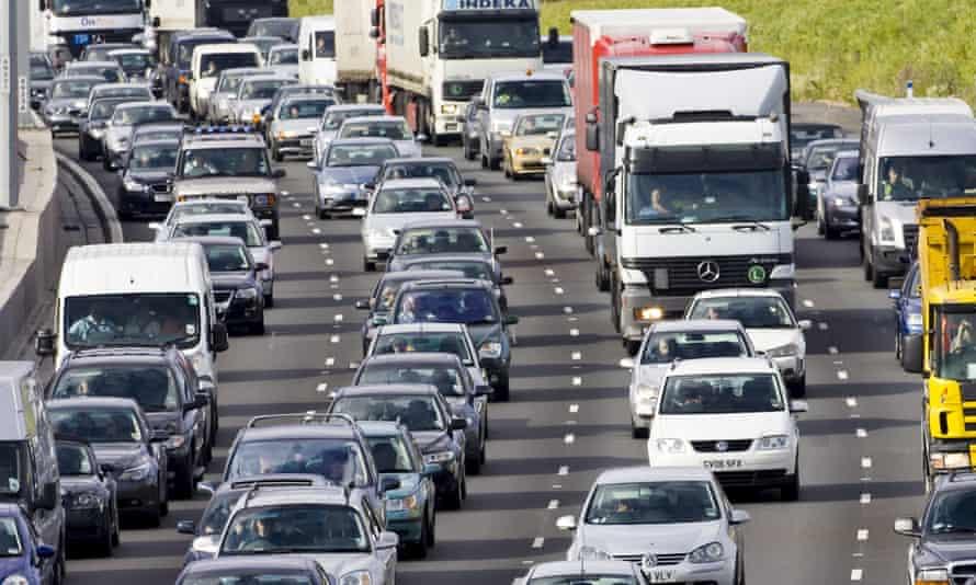 Traffic congestion cars and trucks on M25 motorway, London