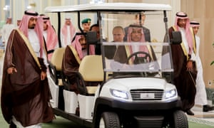 King Salman bin Abdulaziz Al Saud with President Putin before talks on Monday in a golf-type buggy