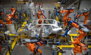 Cars being manufactured in the Aluminium Body Shop, at Jaguar Land Rover's Advanced Manufacturing Facility in Solihull, Birmingham.