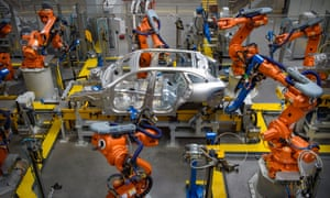 Cars being manufactured in the Aluminium Body Shop, part of Jaguar Land Rover's Advanced Manufacturing Facility in Solihull, Birmingham.