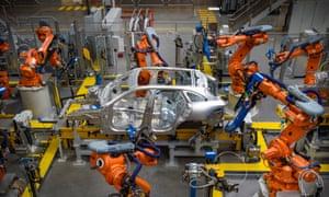 Robots build a car on a production line