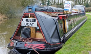 Canal narrowboat selling cheese, moored on the Grand Union Canal.