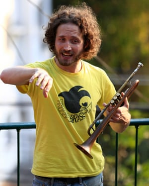 British man Tom Ashe, 36, a professional trumpet player and the founder of Favela Brass. Tom's love of Brazilian live music brought him to Rio, where he lives in the same favela as the children
