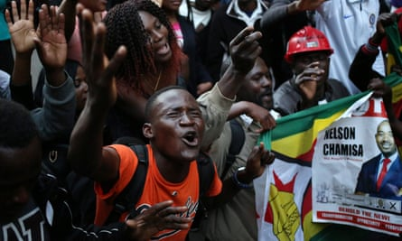 MDC supporters celebrate outside the party's headquarters in Harare