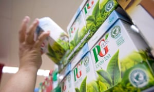 A person reaching for a box of PG Tips