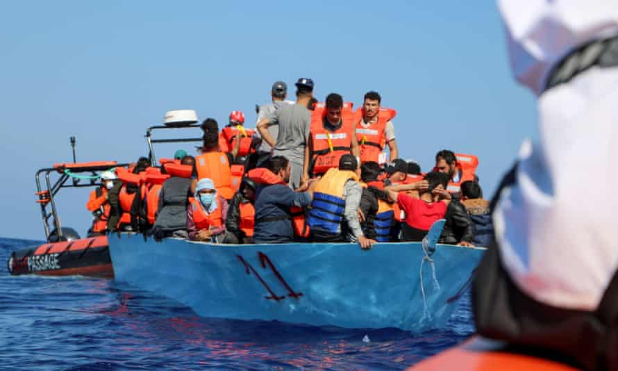Doctors Without Borders (MSF) rescue migrants from a boat off the coast of Libya on 11 June.