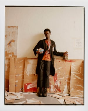 Black coat and hand painted t-shirt by Raf Simons. Black trousers by Acne Studios. Boots, by Roa
