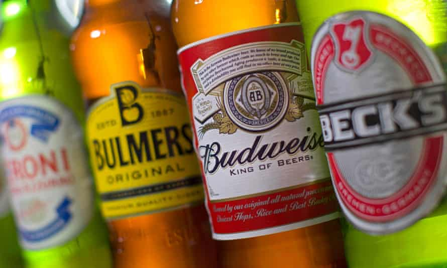 (FILES) A file picture taken in London on October 13, 2015, shows bottles of beer and cider produced by Belgian-Brazilian group Anheuser-Busch InBev, (Budweiser and Beck's) and British brewer SABMiller (Peroni and Bulmers).