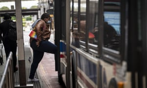 A commuter wearing a protective mask boards a Chicago Transit Authority bus in Chicago, Illinois, US, on Wednesday, 3 June 2020.