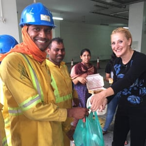 Niaz Zomorodian giving food to local construction workers at her Dubai fridge
