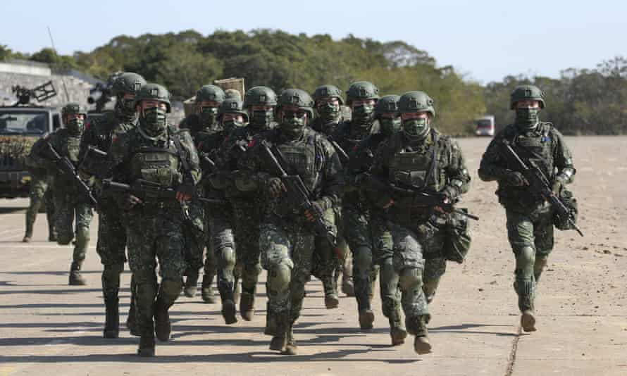 Taiwanese troops using tanks, mortars and small arms staged a drill on Tuesday aimed at repelling an attack from China.