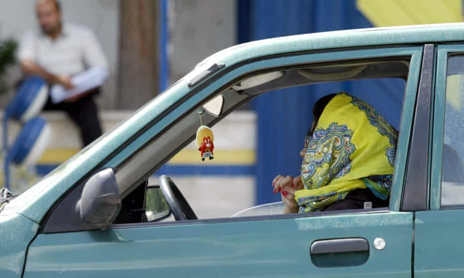 An Iranian woman driving her car in Tehran.