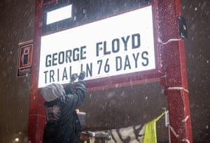 Billy Briggs changes a sign to read 'George Floyd Trial In 76 Days' in Minneapolis, Minnesota