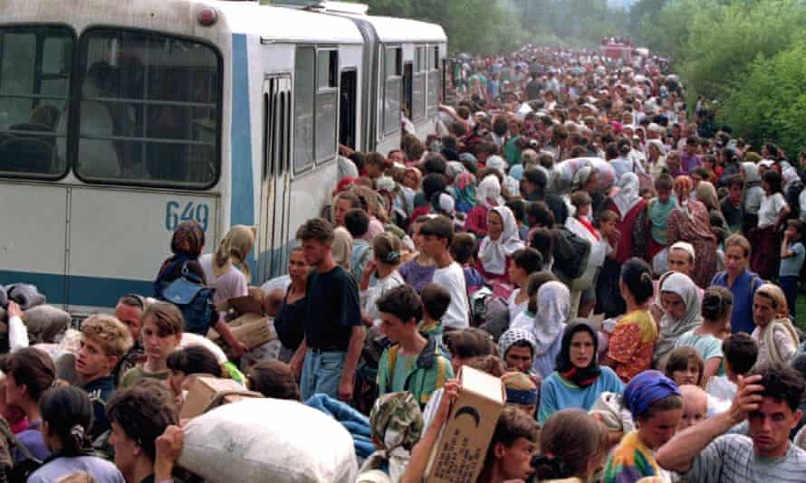 Refugees fleeing Bosnian Serb troops gather at Tuzla airport, eastern Bosnia, in July 1995.