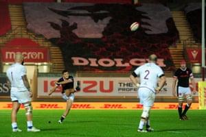 Callum Sheedy of Wales kicks a penalty.