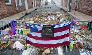 Flowers, candles and other items are placed in memory of Heather Heyer in Charlottesville, VA.