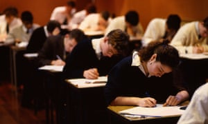 Schoolchildren taking their GCSE exams.