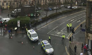 Police secure an area outside the University of Glasgow