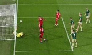 Roberto Firmino slots home Liverpool's equaliser.
