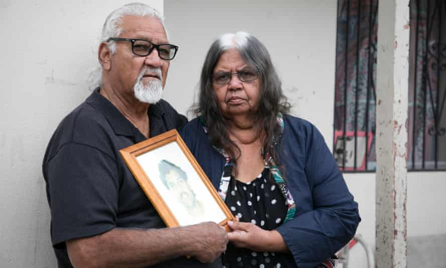 Helen and Ted Russell with a photo of their son Edward Russell who died in custody.