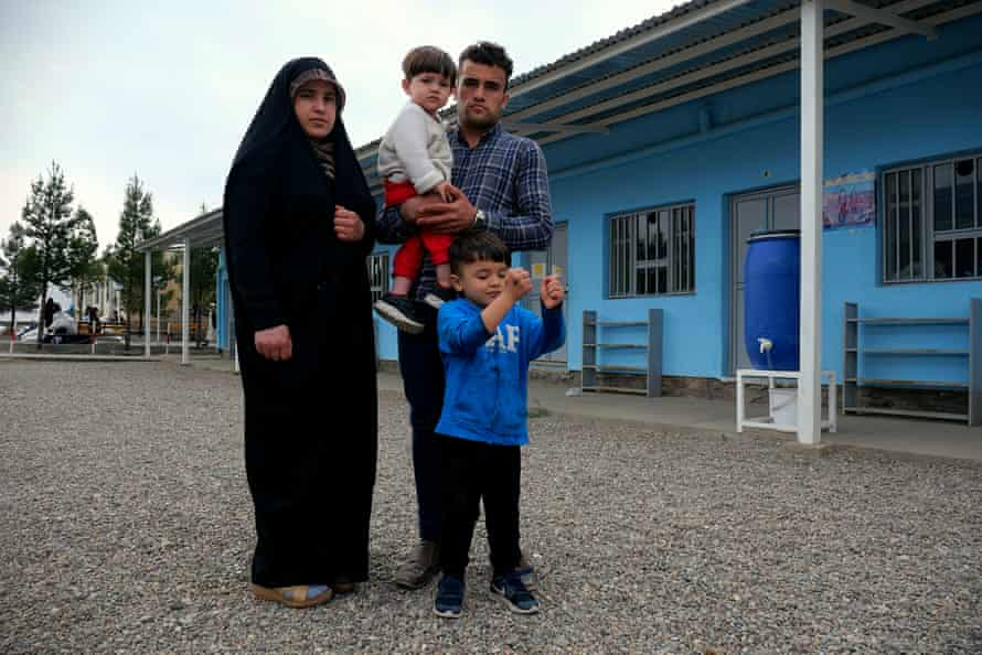Hafizullah with his pregnant wife, Shaiesta, and their two young children at a transit camp in Herat, where they were taken after being arrested in Tehran, Iran