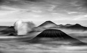 By Zac Patsalides, runner-up. Sulphur gas spews out of Mount Bromo (left) in East Java, Indonesia, at sunrise while low-lying clouds move around Mount Semeru (in the background) and Mount Batok (foreground) in the morning light.PAUL GOLDSTEIN, JUDGE: Black and white is a very bold choice for this. Apart from it being a little on the noisy side, this is a beautiful image from a photographer that knows their onions. On another month, this would probably have won.