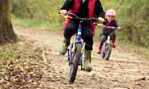 A boy and girl cycling