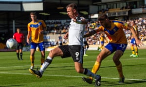 Port Vale striker Tom Pope controls the ball during a match against Mansfield.