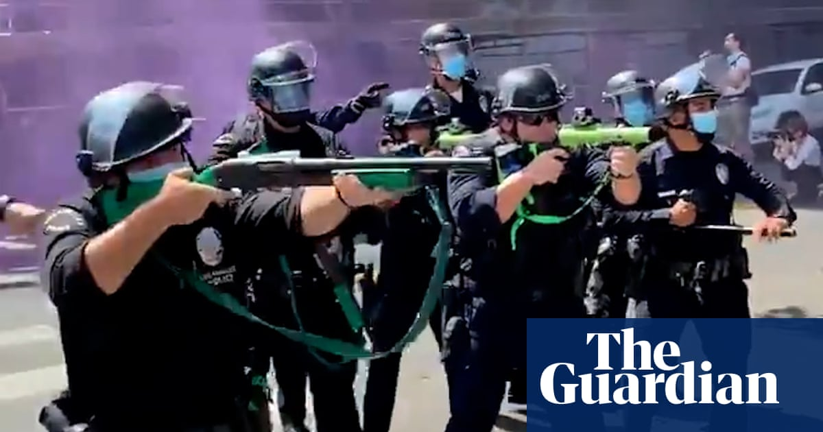 Police fire rubber bullets after anti-trans rights protest at Los Angeles spa turns violent – video