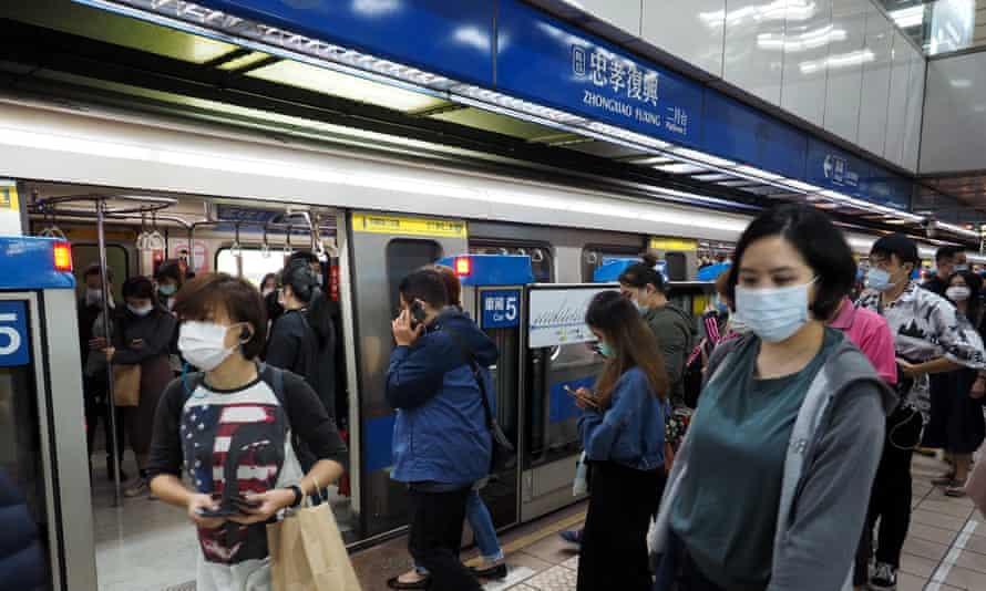 Commuters in Taipei, Taiwan. Officials have told people to continue wearing masks to combat the spread of Covid-19.