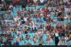 Fans in the stands show their support.