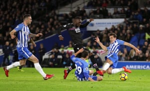 Christian Benteke is tackled by Markus Suttner and Lewis Dunk.