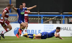 Declan Patton scores Warrington's fourth try on the full-time hooter against Wigan.