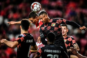 Benfica's Carlos Vinícius (left) goes up for a header with Moreirense's Iago Santos during their 1-1 draw in the Portuguese league.