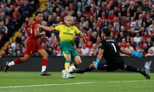 Liverpool's Alisson blocks a shot from Norwich City's Teemu Pukki.