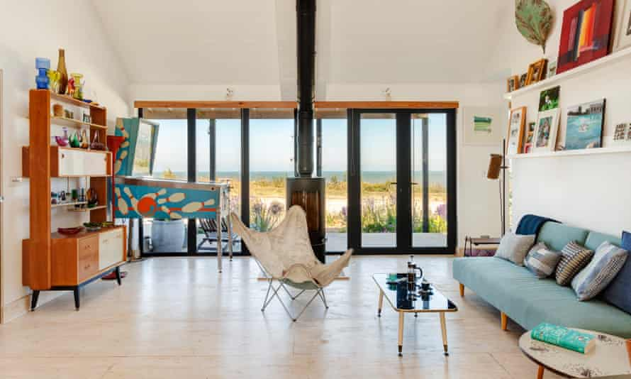 Rooms with a view: the ground floor has floor-to-ceiling windows to the front and rear.